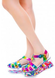 alice-is-wet:  glitterswitch:   Y.R.U Charii Shoes from dollskill aka the most incredible shoes on this planet. The bottoms open up so you can put whatever you want in them and customize them to your own style.  Rainbow || Glitter  NO BUT I NEED THESE PRECISELY TO PUT KANDI IN THEM.  oh I could do these. fill them with glitter.