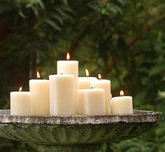 A birdbath filled with candles.  How romantic!  Great evening outdoor wedding or party idea.