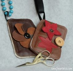 Leather needle book with scissor stash. Made from recycled leather.