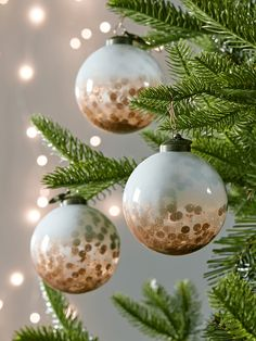 love these handmade milky glass baubles with copper and sequins inside by somerset based Cox & Cox. click through for more special christmas decorations you'll love to hang year after year Christmas Trends, Modern Christmas, Christmas Inspiration, Beautiful Christmas, Winter Christmas, Christmas Tree Ornaments, Christmas Crafts, Christmas Booth, Handmade Christmas Decorations