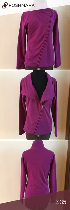 "NWT PUMA ASYM JACKET IN PURPLE. Super cute and super versatile. NWT workout or go out in style jacket. Asymmetrical zipper for fully closed no collar or part zip for full collar. 2 side pockets. Size Small. 17.5"" under arms, 16"" at tapered waist and 24-25"" overall length. Puma Jackets & Coats"