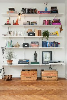 Living room shelving inspiration. Can probably buy this simple shelving system at Home Depot