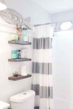 Seaside Inspired Bathroom - Nautical Bathroom - House Beautiful - Shelves above toilet