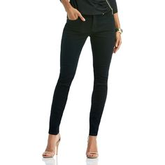 Harder, better, faster, stronger. That's you in these sexy total solution skinny-fit jeans from Nicki Minaj. The mid-rise three-button waist flattens your tummy while the butt-enhancing back yoke lifts, accentuates and enhances your natural curves. With a tummy-flattening, mid-rise waist and high-tech, tush-lifting back yoke, you'll be killin' it with curviness everywhere you go.