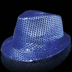 Nothing is as stunning as blue sequins. Take the trendy style fedora and add blue sequins and have a great new look with our blue sequin fedora. Perfect anytime blue fits your color scheme. Our blue sequin fedora is sold by the piece. Please order in increments of 1 piece. This item may or may not be able to be imprinted, please inquire to be certain. If it can be imprinted there will be an additional charge for doing so.