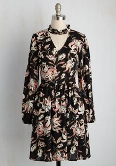 You'll feel so radiant in this black dress that even the fauna will smile at your style! Sweetly ruffled and sophisticatedly buttoned at the neckline, this gathered-waist frock offers a vintage-inspired air. Plus, its pink, ivory, teal, and brown lily print are as sentimental as the flowers you've fondly flattened in the pages of a book!