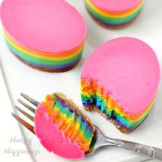 Brighten up your Easter table by serving these lusciously creamy Rainbow Cheesecake Easter Eggs with purple, blue, green, yellow, orange, and pink layers.