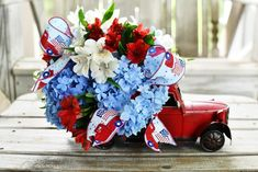 DIY patriotic flower centerpiece with a red truck | ©homeiswheretheboatis.net #patriotic #tablescape #centerpiece #flag #4thofjuly Flower Centerpieces, Flower Arrangements, Fourth Of July, 4th Of July Wreath, Small American Flags, Table Setting Inspiration, Floral Foam, Flower Boxes, Independence Day