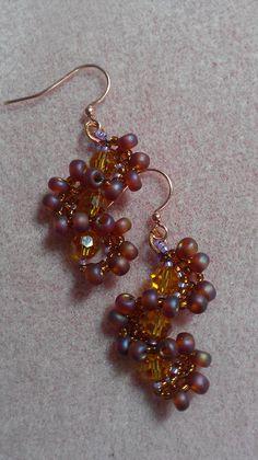 Whirlygig Earrings in copper: Design by Jill Wiseman, made by Jennifer Ehrichs