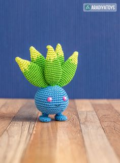 """Please note that this is a crochet pattern (PDF file), but not a toy. The file will be available for download immediately after purchase. This crochet pattern contains a detailed description of how to create Oddish, with a great amount of step-by-step photos and a list of necessary materials. Oddish – character from popular franchise """"Pokemon"""" that is managed by The Pokémon Company, a Japanese consortium between Nintendo, Game Freak, and Creatures. Materials needed to create a 3.75-inches…"""