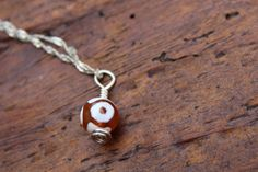 "Orange Glass ""Evil Eye"" Charm/Pendant by BeTheDreamerJewelry on Etsy"