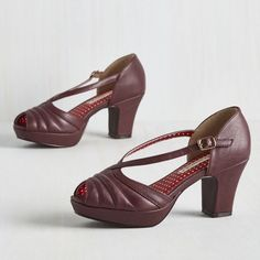 """I See Strut You Mean Heels Brand new in box. Vegan faux leather peep toe platforms in a deep berry color. Adjustable straps with a gold buckle. Adorable quilted accents. Platform measures 1"""", heel measures 3"""". All man-made materials. ModCloth Shoes Heels"""