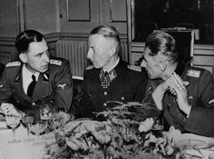 SS officers Erich Weinmann, Heinrich Heinz Reinfarth, and Karl Hermann Frank converse during a banquet celebrating the brutal suppression of the Warsaw Ghetto Uprising. Over 13,000 Jews were killed by SS under the supervision of Jürgen Stroop, who made the ludicrous claim that only 16 Germans were lost during the conflict.  The remaining 50,000 Jews were sent to Treblinka.  Treblinka, it should be noted, was not a concentration camp.  It was an extermination camp.