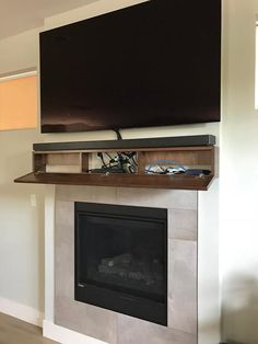 Modern walnut fireplace mantel with drop front shelf, media storage, hidden storage. 15 Best Hidden Storage Ideas and Designs for 201915 Best Hidden Storage Ideas and Designs for Fireplace Cabinet with Hidden Storage Tv Over Fireplace, Home Fireplace, Fireplace Remodel, Living Room With Fireplace, Fireplace Design, Fireplace Mantels, Fireplaces With Tv Above, Fireplace Modern, Faux Fireplace