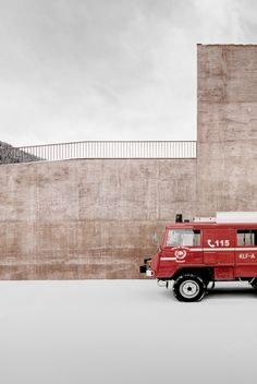 Italian studio Pedevilla Architects has used red pigmented concrete to give an Alpine fire station in South Tyrol a muted yet distinctive colouring The Plan, Arch Building, Concrete Facade, Alpine Village, Timber Cladding, South Tyrol, Facade Architecture, Library Architecture, Northern Italy