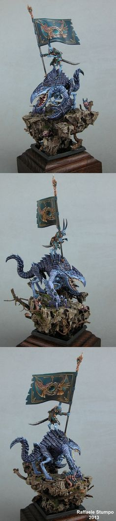 Demon riding bigger Demon, some sort of Tzeetch Warhammer Army Standard maybe.