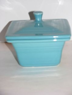 Fiesta® Dinnerware Square Covered Box in Turquoise. Also referred to as Belk Box since this design was created exclusively for Belk Department Stores by the Homer Laughlin China Company. Made in America Ball Jars, Homer Laughlin, Covered Boxes, Made In America, Canisters, Dinnerware, China, Turquoise, Coast
