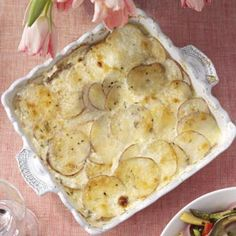 Parmesan Potatoes Au Gratin...This is an amazing recipe!  I used my new Kitchenaid Food Processor and it made slicing the potatoes so so so easy!