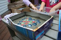 Make your own stepping stones: reuse empty boxes to use as the molds for the cement.