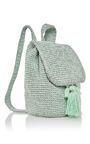 This **7II** backpack features a hand woven mint and sparkly silver body with tassel at the front, inside pocket, and round transparent plexiglass bottom.