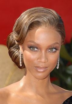 Tyra Banks- brown green eyes