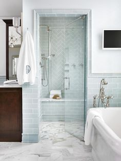If you keep up with the news while you get ready in the morning, consider installing a small television in your remodeled bathroom. #bathroomideas #bathroomremodel #newbathroom #bathroomdecor #bhg Bathroom Color Schemes, Bathroom Colors, Bathroom Sets, Bathroom Mirrors, Bathroom Cabinets, Bathroom Fixtures, Chic Bathrooms, Modern Bathroom, White Bathroom