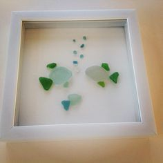 Sea glass fish, but you could paint rocks like decorative fish and put in the shadow box as well including little rocks for bubbles!