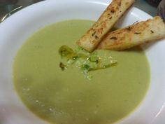 Asparagus soup with garlic bread stick