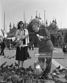 Belorussian painter Marc Chagall with his wife in St. Mark Square, Venice, 1948.