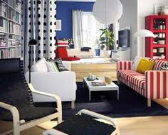 Super excited about the basic colors used in this living room! I'd love to pull some of the key elements out, like the red striped sofa, book shelf and the polka dotted curtain and incorporate them into a play room.