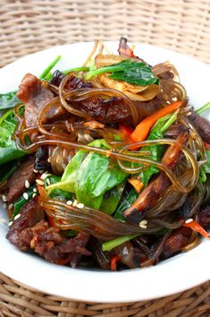rice noodle dishes, including Chap Chae (Stir-Fried Sweet Potato Noodles With Beef, Spinach And Sesame Seeds) Sweet Potato Stir Fry, Sweet Potato Noodles, Asian Recipes, Healthy Recipes, Ethnic Recipes, Indonesian Recipes, Orange Recipes, Chap Chae, Sesame Seeds Recipes