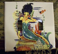 Retro!  mermaid double switch plate retro vintage 1950's pin up girl light switch. $9.95, via Etsy.