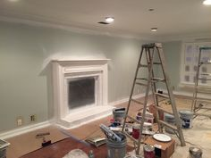 WORK IN PROGRESS on the living room. As you can see we added lighting, changed the paint color, painted the fireplace