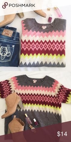 Cute colorful chevron design sweater ☕️ This adorable sweater has great colors, warmth, and goes great with jeans - what more could a girl want?! It is labeled a XXL, but looks to me like it would work better for a XL or maybe oversized for a smaller size. Super comfy and cute 😍 Sweaters