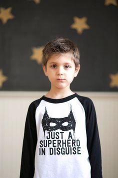 Super Hero is printed on a white three quarter sleeve baseball tee, with sizes between 2t-6. If you are looking for another size, feel free to