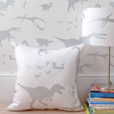 'D'ya-think-e-saurus' White & Silver children's dinosaur fabric and wallpaper is lovely and fresh. We don't sell the accessories shown here, but we do sell the fabric (by the metre) used to make them.