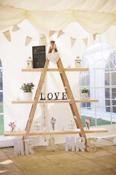 Cute Homespun Marquee Indoor Picnic Wedding Ladder Decor http://www.milkbottlephotography.co.uk/