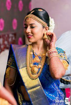 South Indian bride. Gold Indian bridal jewelry.Temple jewelry. Jhumkis.Blue silk kanchipuram sari.Braid with fresh flowers. Tamil bride. Telugu bride. Kannada bride. Hindu bride. Malayalee bride.Kerala bride.South Indian wedding.