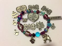 Two Charms of Your Choice - Rescue Bracelet - Made to Order - Donation to Rescue. $18.50, via Etsy.