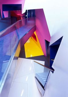 Surface Architects won this commpetition to design  the permanent home of the Film & Visual Research Center in the Birkbeck College.  They transformed the basement, ground floor and the extension into a unique 80 seat cinema auditorium, surrounded by a media study suite, seminar rooms and offices. The beak-out spaces and stairway are an exuberant display of pure form and color.