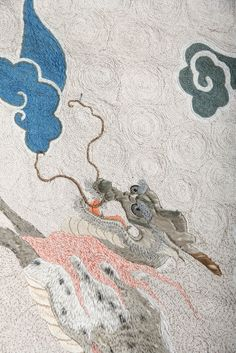 Japan, late 19th century. Silk hanging or tablecloth with pearl, stylized clouds, and four kirin, or horned creatures (detail).
