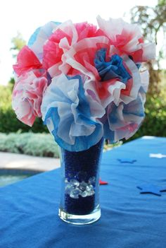 Coffee Filter Flowers as cheap quick centerpiece for the one table.  SO danged easy and I still have everything but the food coloring left over from my wedding.