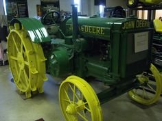 """John Deere two cylinder model D. The D had the longest production run of any John Deere tractor, from 1923-1953. This is a 1925 model which would have had a 465cid, 6.50"""" bore x 7.00"""" stroke, 3.91:1 compression ratio engine running at 800 RPMs. At Nebraska it produced 22.53 drawbar hp and 30.40 belt horsepower. Marketed as a 2 or 3 plow tractor, depending on soil conditions."""