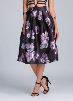 You know the girly-girl inside of you is so down to wear this chic floral a-line skirt.