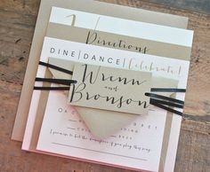 Square Bronson Wedding Invitation Suite with Ribbon Tie and Monogram Tag - Champagne Gold, Black, Ivory (colors/text customizable). $2.99, via Etsy.