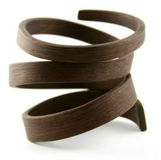 Bent wood jewelry by Gustav Reyes.