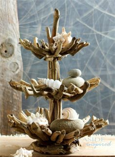 drift wood 3 tier stand and shells. This could also be made from woodland branches, lichen, pine cones, etc. lr | best stuff