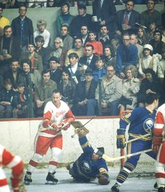 Gordie Howe fights for position in front of goalie Joe Daley during a 1971 Red Wings-Sabres game. (Walter Iooss Jr./SI) GALLERY: All-Time Oldest NHL Players #EasyPin