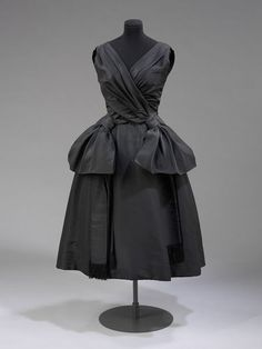 1957, England - Evening dress by Marc Bohan for Dior London - Silk poult, with silk lining, metal coil boning, and silk and nylon net petticoats