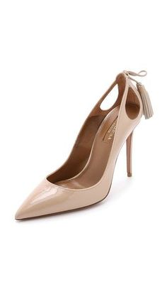 Nude pumps and tassels